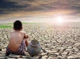 Sad boy sitting on dry ground and sunset . (Shutterstock/ File Photo)