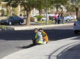 Construction workers resting on the street at lunchtime (Shutterstock)