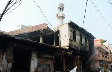 The mosque was set on fire in the Indian capital on Tuesday by Hindu mobs [Sajjad Hussain/AFP]