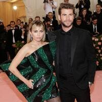 Miley Cyrus L pictured with Liam Hemsworth voiced her love for Hemsworth on their 10 year anniversary as a couple File Photo by John Angelillo UPI License Photo