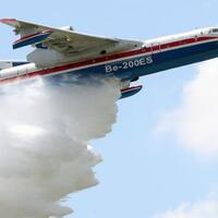 A Russian Beriev BE 200 amphibious aircraft performs a demonstration flight on the opening day of the 54th International Paris Air Show at Le Bourget.