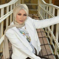 Ola Al Fares asked Amal Hijazi if she would give uphijab if she wasoffered threemillion dollars andreturn to the entertainment industry Source amalhijazy Instagram