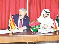Head of Olympic Committee of Kuwait Sheikh Fahad Al-Nasser and Head of Spain's Olympic Committee Alejandro Blanco Bravo during the signing ceremony in Doha, Qatar.