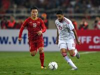 Vietnam's Nguyen Quang Hai (left) fights for the ball with UAE's Jassim Yaqoob Al Balooshi during the World Cup qualifier in Hanoi.