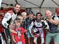 Frode Sundsdal (right) with Rashed Al Qemzi, Rashid Al Tayer (left) and young fans at the Grand Prix of Norway earlier this year. (Supplied photo)