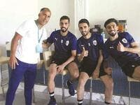 (From left) Former Al Sadd midfielder Felipe Jorge poses with current players Hassan al-Haydos, Ali Assadalla and Tarek Salman during a training session. (Twitter/AlsaddSC)