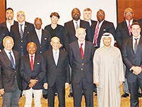 Chairman of FINA Julio Maglione with First Deputy Chairman of FINA Hussain Al-Musallam pose for a group photo during the FINA meeting in Kuwait.