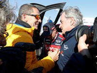 Bahrain JCW X-Raid Team's Carlos Sainz after winning the Dakar Rally alongside Yann Le Moenner, CEO of A.S.O.