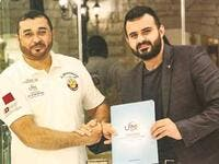 Qatari rally driver Khalid al-Mohannadi (left) with Universal Sports' marketing director Zaid Yaaroub after signing a sponsorship agreement. (Photo: Gulf Times)