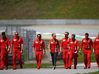 Ferrari's Sebastian Vettel walks the circuit with his team members at the Red Bull Ring in Spielberg, Austria, on Thursday. - Twitter