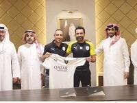 Santi Cazorla (centre) poses with Al Sadd's head coach Xavi Hernandez (second from right) and other club officials after signing a two-year contract. (Photo: Gulf Times)