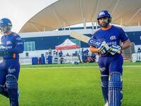 Mumbai Indians captain Rohit Sharma (right) goes out to bat during a practice match. (MI Twitter)