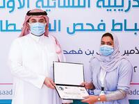 Prince Fahad bin Jalawi awarding doping control officer certificates to Saudi women after completion of their training course. (Supplied)