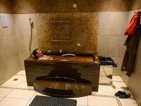 A man bathes in a tub filled with Naftalan crude oil during a treatment session at Qarabag luxury resort in Naftalan, some 300 kilometres (186 miles) from capital Baku, on March 21, 2019. Immersed up to her neck in crude oil, a Russian woman suffering from joint disease smiles in delight, confident that the treatment at a spa in northwestern Azerbaijan will cure her painful condition.  Mladen ANTONOV / AFP