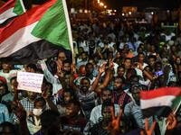 Sudanese protesters wave flags and flash victory signs as they gather for a sit-in outside the military headquarters in Khartoum on May 19, 2019. (AFP/ File Photo)