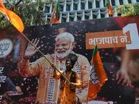 An Indian supporter of Indian Prime Minister Narendra Modi's Bharatiya Janata Party (BJP) celebrates the election results outside the BJP headquarters in Mumbai on May 23, 2019. (AFP/ File Photo)