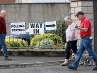 People leave and arrive at a polling station for the European Parliament elections at Bannside Presbyterian Church in Banbridge Co Down, northern Ireland, on May 23, 2019. (AFP)