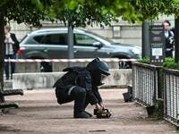 A bomb disposal expert works at the scene of a suspected package bomb blast along a pedestrian street in the heart of Lyon, southeast France, on May 24, 2019. (AFP/ File Photo)