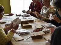 Election officials count pre-votes of the European parliament elections in Helsinki, Finland on May 26, 2019. (Emmi Korhonen / Lehtikuva / AFP)