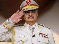 Libyan military commander Khalifa Haftar salutes during a military parade in Benghazi in May 2018. (AFP)