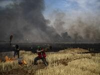 People battle a blaze in an agricultural field in the town of al-Qahtaniyah, in the Hasakeh province near the Syrian-Turkish border on June 10, 2019. Fires have erupted in various parts of Syria in recent weeks, with all sides blaming each other for starting them. Delil souleiman / AFP
