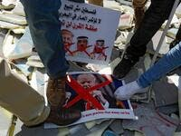 "Palestinians stamp on protest signs showing the crossed-out faces of (L to R)  Israeli Prime Minister Benjamin Netanyahu, US President Donald Trump,  King Hamad al-Khalifa of Bahrain, and Saudi Crown Prince Mohammed bin  Salman, with a caption above in Arabic reading ""Palestine is not for sale,  no to the conference of shame in Bahrain, the deal of the century will not pass"". Musa Al SHAER / AFP"