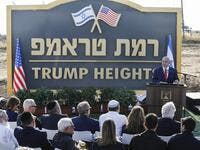 "Israeli Prime Minister Benjamin Netanyahu gives a speech before the newly-unveiled sign for the new settlement of ""Ramat Trump"", or ""Trump Heights"" in English, named after the incumbent US President during an official ceremony in the Israeli-annexed Golan Heights on June 16, 2019. (AFP/ File Photo)"