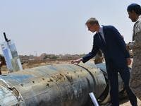 "Brian Hook (2nd R), the US special representative on Iran, checks what Saudi officials said were Iranian remnants of a ""cruise missile"" that slammed into Abha airport on June 12, during a visit to an army base in al-Kharj, south of the Saudi capital Riyadh, on June 21, 2019. (AFP/ File Photo)"