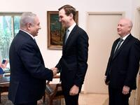 US President Donald Trump's son-in-law and adviser Jared Kushner shakes hands with Israeli Prime Minister Benjamin Netanyahu during a meeting in Jerusalem, with Trump's aide for international negotiations Jason Greenblatt looking on (AFP Photo)