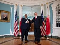 US Secretary of State Mike Pompeo (R) shakes hands with Bahraini Foreign Minister Khalid bin Ahmed Al Khalifa (L) prior to meetings at the State Department in Washington, DC, July 17, 2019.  SAUL LOEB / AFP