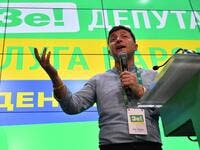 Ukrainian President Volodymyr Zelensky gives a speech at his Servant of the People party's election headquarters in Kiev on July 21, 2019, following a day of polling in the country's parliamentary election.  GENYA SAVILOV / AFP