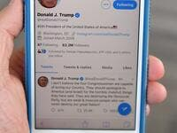 A July 21, 2019 photo of a cell phone showing the Twitter page of US President Donald Trump in Morristown, New Jersey. Trump renewed his attack on four Democratic congresswomen. MANDEL NGAN / AFP