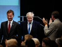 Conservative Party leadership candidates Jeremy Hunt (L) and Boris Johnson (C) arrive in the auditorium at an event to announce the winner of the Conservative Party leadership contest in central London on July 23, 2019. (Tolga AKMEN / AFP)
