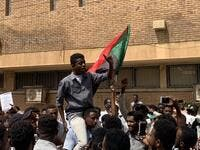 A Sudanese protester is lifted on the shoulders of another while chanting slogans during a demonstration commemorating protesters killed during past clashes, in the centre of the capital Khartoum on July 23, 2019.  Haitham EL-TABEI / AFP