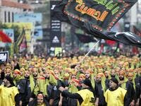 Supporters of Lebanon's Hezbollah movement take part in a parade. (AFP/ File Photo)