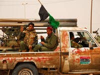 Libyan rebels travel to a battle (Shutterstock)