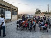 Hinde is screening films in remote villages using just a laptop, projector and a canvas screen. With some films dubbed into Kurdish and others subtitled, he and a team of volunteers want to spread their love of cinema across Rojava, the Kurdish name of the semi-autonomous northeast of war-torn Syria. DELIL SOULEIMAN / AFP