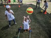 Palestinian amputee children play during a summer camp origanized by the Palestinian Children's Relief Fund (PCRF) in the town of Khan Yunis in the southern Gaza strip on August 3, 2019. SAID KHATIB / AFP