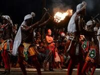 "In this photograph taken on August 14, 2019 dancers perform during the ""Esala Perahera"" festival near the Buddhist temple of the Tooth in the ancient hill capital of Kandy, some 116 kilometres from Colombo. Lakruwan WANNIARACHCHI / AFP"