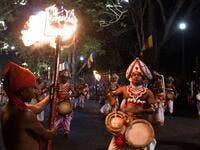 "In this photograph taken on August 14, 2019 musicians perform during the ""Esala Perahera"" festival near the Buddhist temple of the Tooth in the ancient hill capital of Kandy, some 116 kilometres from Colombo. Lakruwan WANNIARACHCHI / AFP"