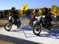 Hezbollah members ride their motorcycles in the Lebanese village of Aitaroun (AFP)
