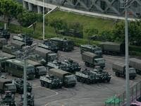 Trucks and armoured personnel carriers are seen parked at the Shenzhen Bay stadium in Shenzhen, bordering Hong Kong in China's southern Guangdong province, on August 16, 2019. (AFP)