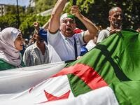 Algerian demonstrators chant slogans and march with national flags as they gather in the streets of the capital Algiers. (AFP/ File Photo)