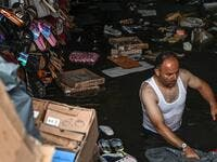 A shop owner tries to save his belongings in a flooded undergate shop center on August 17, 2019 in Eminonu district in Istanbul, after a heavy rainfall. Ozan KOSE / AFP