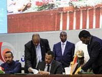 "Sudan Army and opposition leader have sign documents during a ceremony to sign a ""constitutional declaration"" that paves the way for a Sudanese transition to civilian rule, in the capital Khartoum on August 17, 2019. (AFP)"
