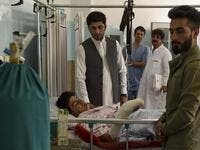 A wounded man receives treatment as people gather around him at the Wazir Akbar Khan hospital after a deadly bomb blast in a wedding hall in Kabul on August 18, 2019. (AFP/ File Photo)