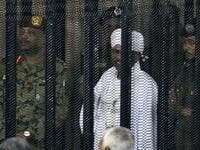 Sudan's deposed military ruler Omar al-Bashir stands in a defendant's cage during the opening of his corruption trial in Khartoum on August 19, 2019. (AFP/ File Photo)