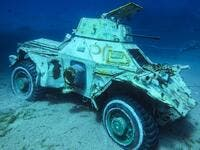 "An armoured vehicle sits amid the clear waters: the museum plans to submerge further attractions in the future for divers to explore. ""Placing these military vehicles in this location will allow coral reefs, corals as well as marine life - including fish, to find a safe sanctuary,"" says Abdullah Abu Awali, manager of the shorelines. (Aqaba Special Economic Zone Authority/AFP)"
