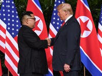 North Korean leader Kim Jong Un shakes hands with US President Donald Trump at the start of their summit in Singapore on Tuesday, June 12. (Saul Loeb/AFP/Getty Images)