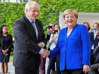Boris Johnson was greeted by Angela Merkel in Berlin this afternoon as he arrived in Germany for showdown Brexit talks (AFP/ File Photo)